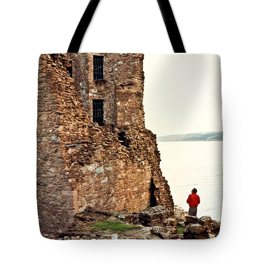 Castle Tote Bag featuring the photograph Castle Ruins On The Seashore In Ireland by Douglas Barnett