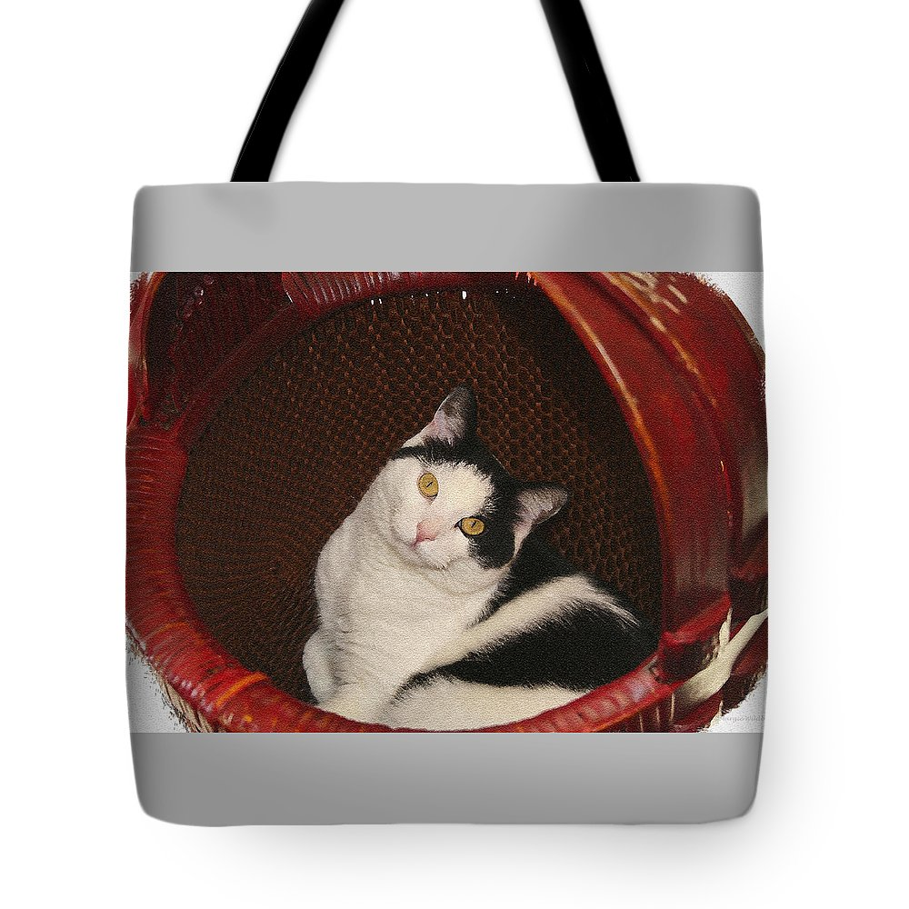 Cat Tote Bag featuring the photograph Cat In A Basket by Margie Wildblood