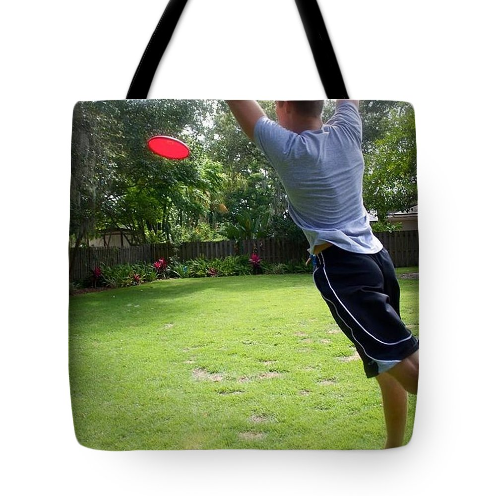 Frisbee Tote Bag featuring the photograph Catching Frisbee by Kendall Tabor