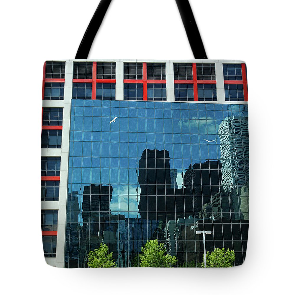 Cbc Toronto Reflection Tote Bag featuring the photograph Cbc Building Tv Screen Of Downtown Highrises by Reimar Gaertner