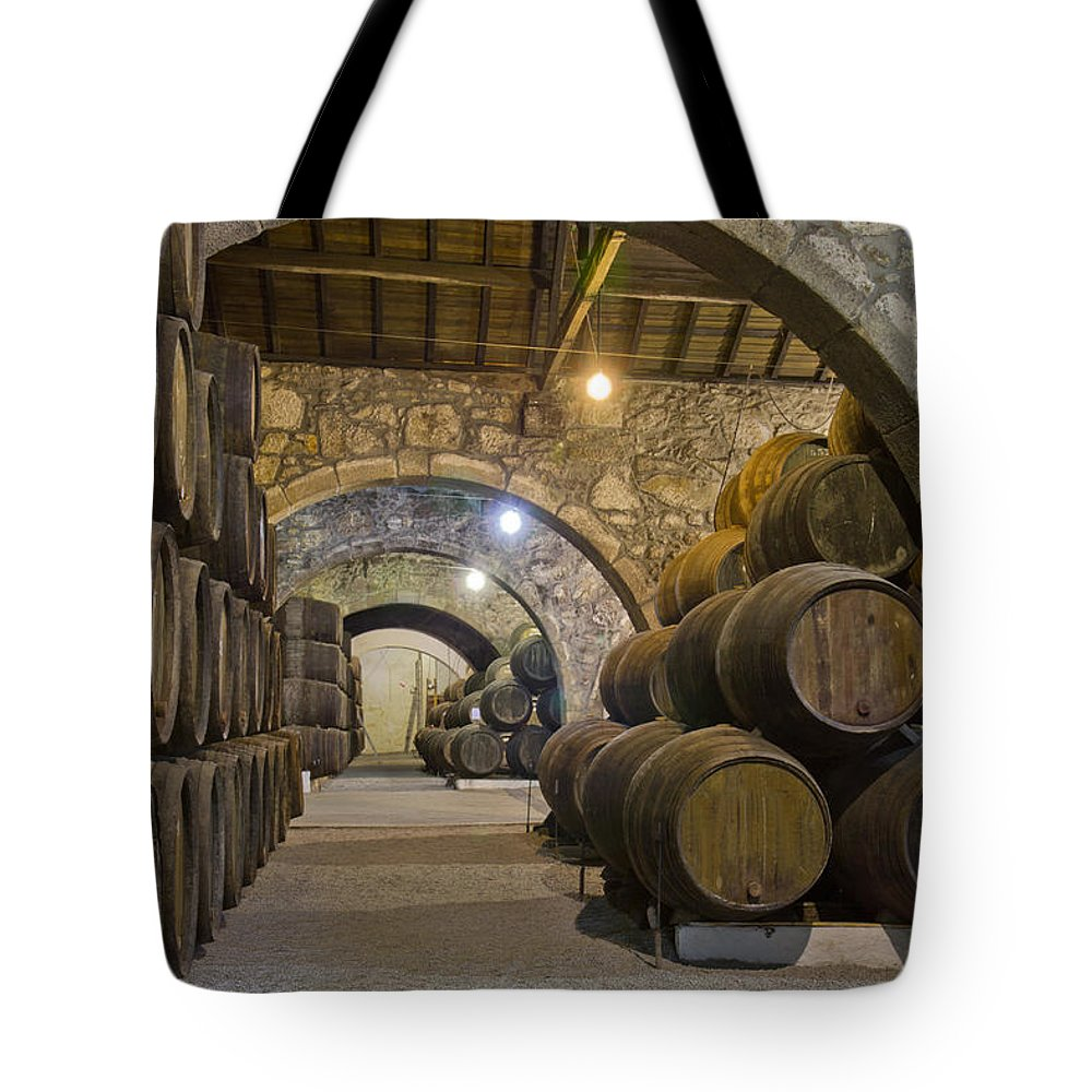 Wine Tote Bag featuring the photograph Cellar With Wine Barrels by Anastasy Yarmolovich