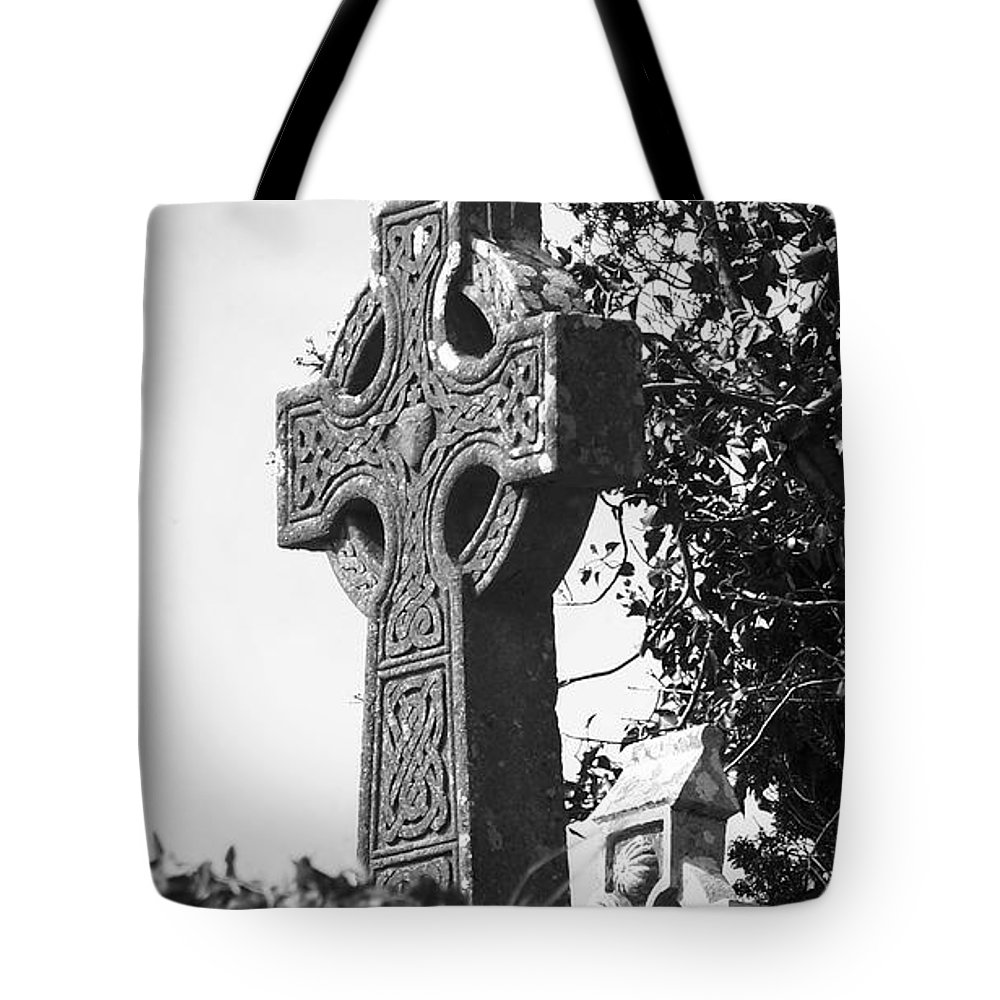 Celtic Tote Bag featuring the photograph Celtic Cross At Fuerty Cemetery Roscommon Ireland by Teresa Mucha