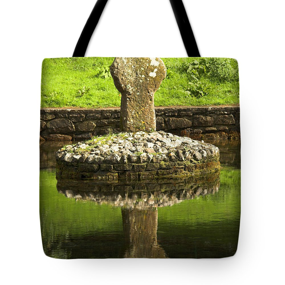 Ancestors Tote Bag featuring the photograph Ancient Celtic Cross At St Patrick Well by Artur Bogacki