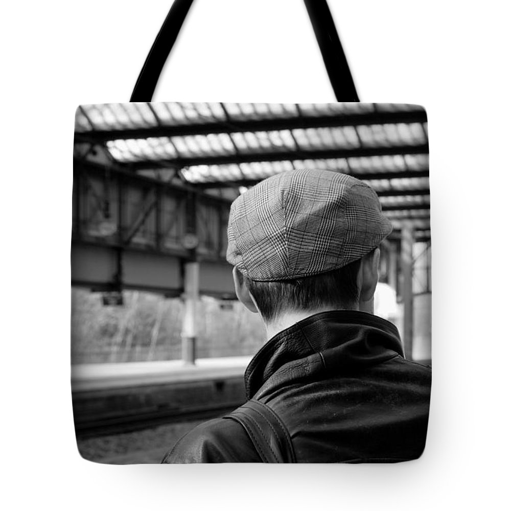 Cap Hat Man Youth Station Trainstation Line Track Commute Commuter Journey Ticket Reportage Documentary Mono Leather Bag Coat Jacket Social Community Victorian Train Ticket Chap Gentlemen England Stoke City Urban Coppola Arrive Arrival Wait Work Look Loco Locomotive Tote Bag featuring the photograph Chap In The Cap #3 by Lens Artist