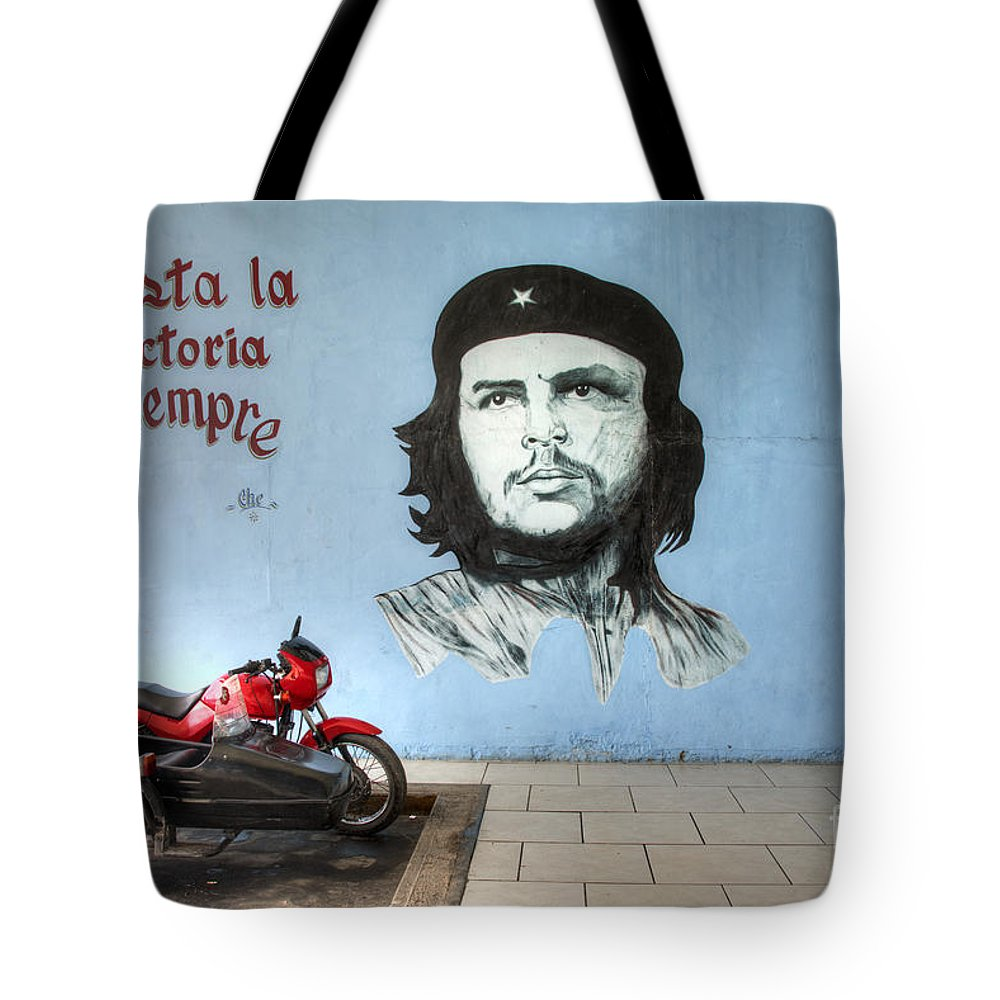 Che Guevara Tote Bag featuring the photograph Che Bike by Rob Hawkins