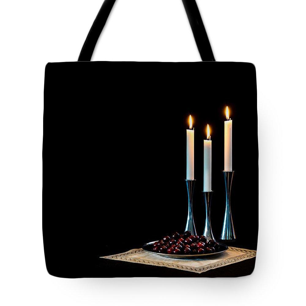 Cherries And Candles In Steel Tote Bag featuring the photograph Cherries And Candles In Steel by Torbjorn Swenelius