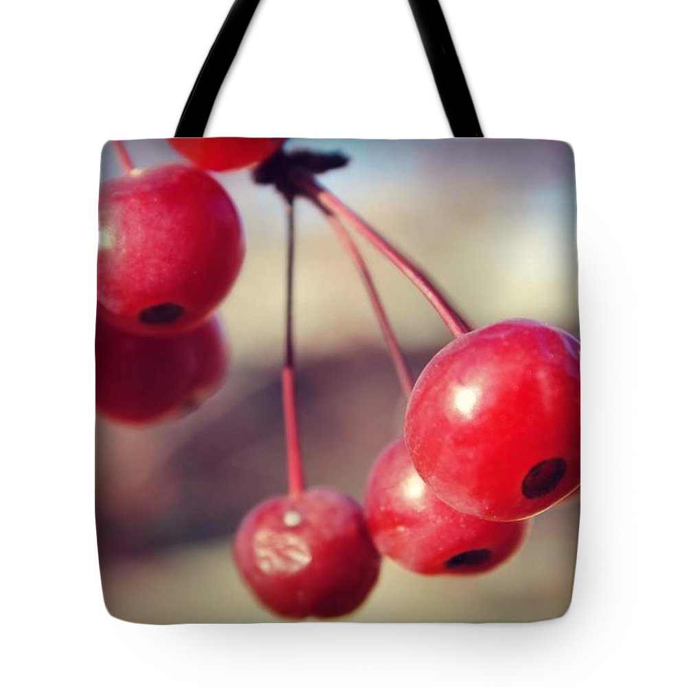Red Tote Bag featuring the photograph Cherries by Brittany Strelluf