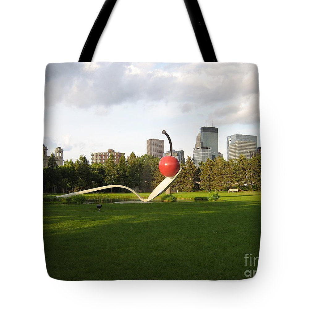 Cherry Bridge Sculpture Tote Bag featuring the photograph Cherry Bridge Sculpture by D Nigon