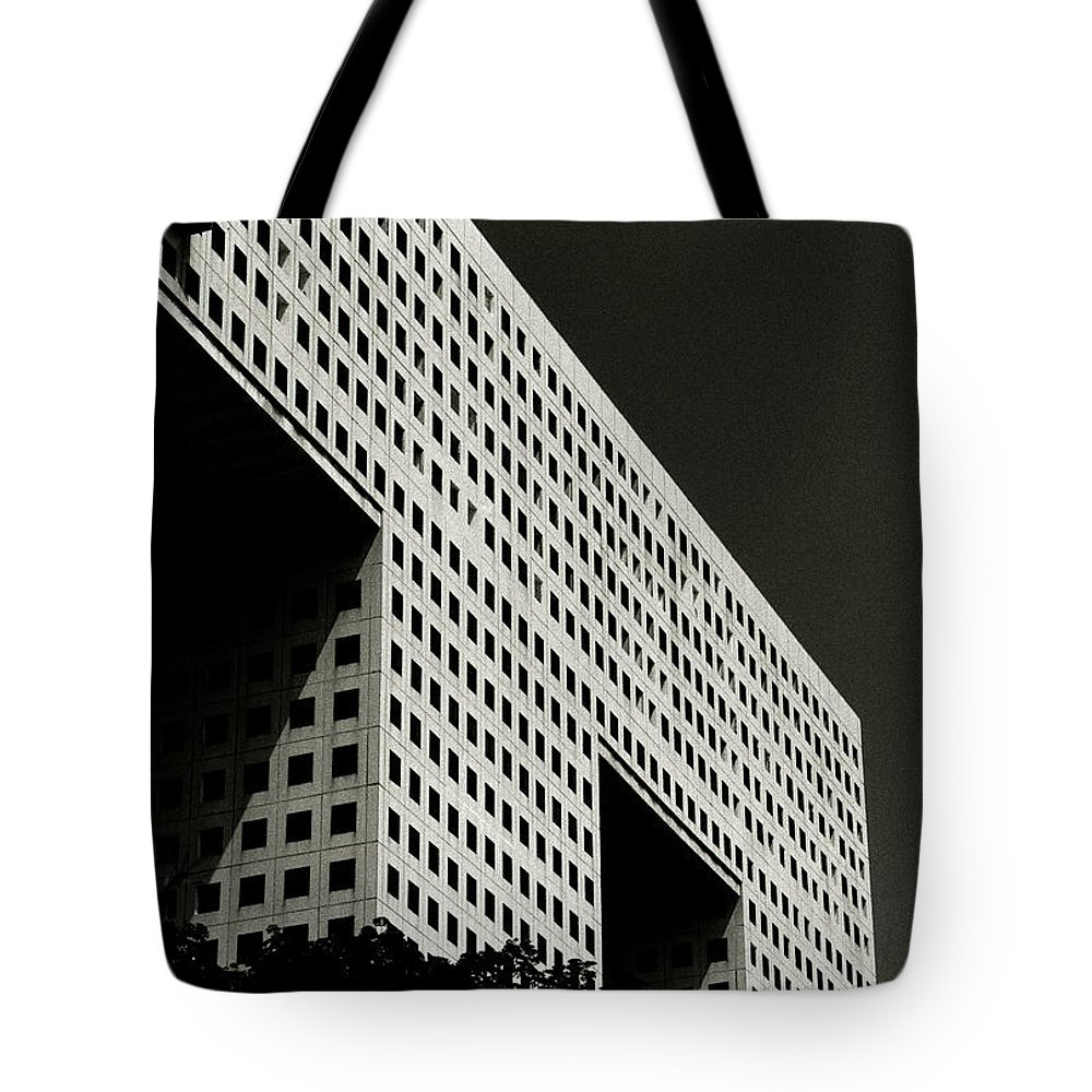 Abstract Tote Bag featuring the photograph Chiaroscuro Construction by Shaun Higson
