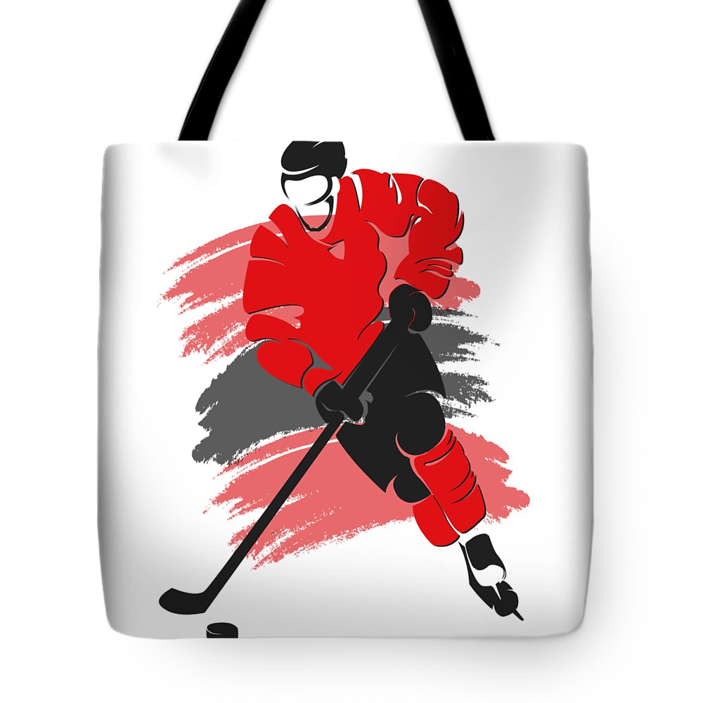 Blackhawks Tote Bag featuring the photograph Chicago Blackhawks Player Shirt by Joe Hamilton