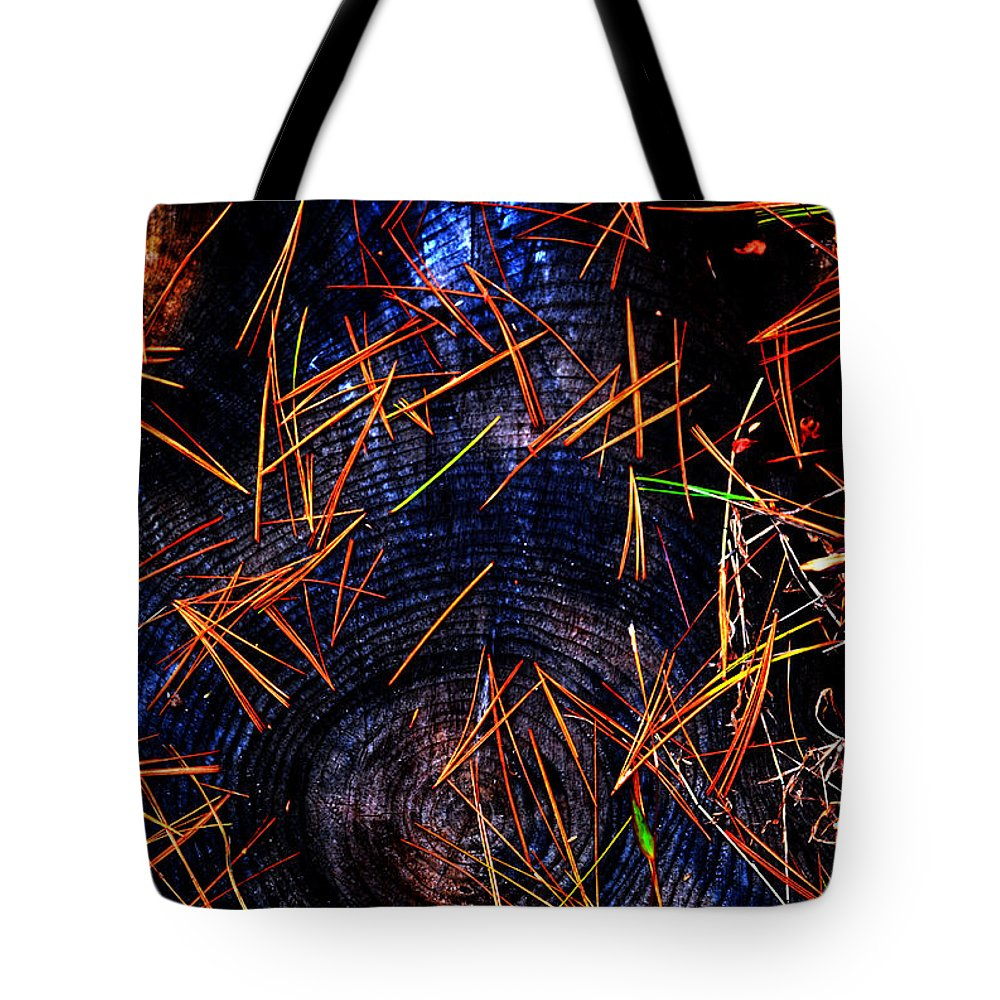 Western North Carolina Tote Bag featuring the photograph Asian Fir Needles On Ancient Round by Susanne Still