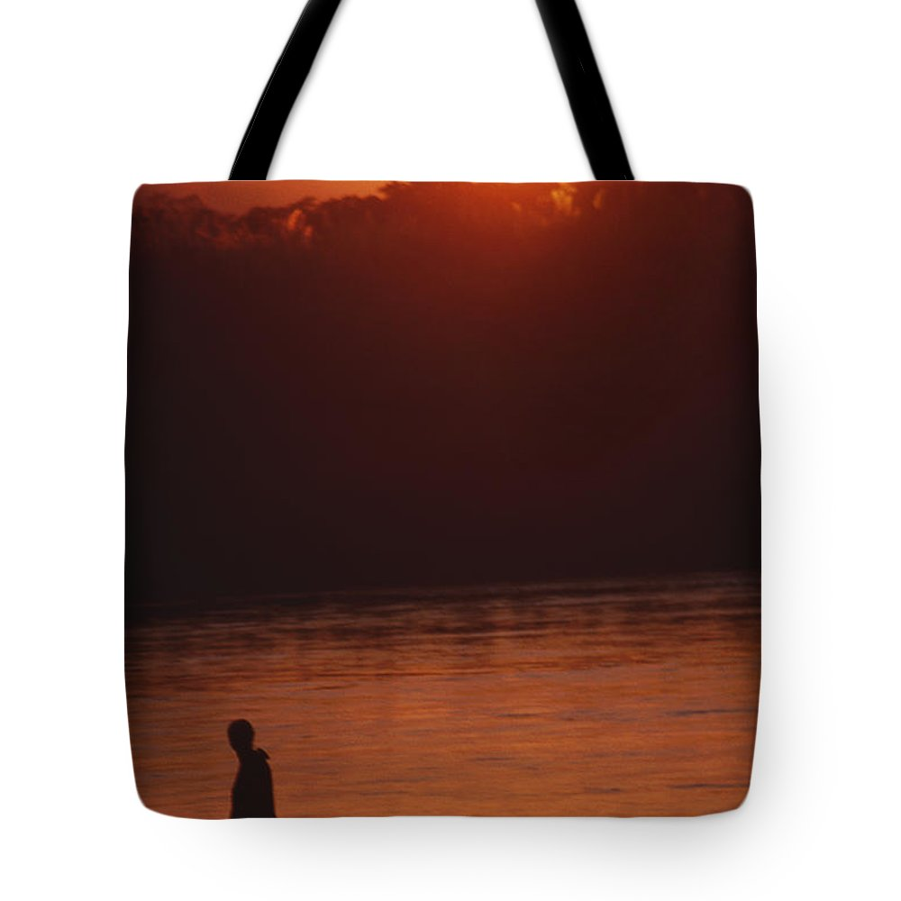 Sunset Tote Bag featuring the photograph Chitwan Sunset by Patrick Klauss