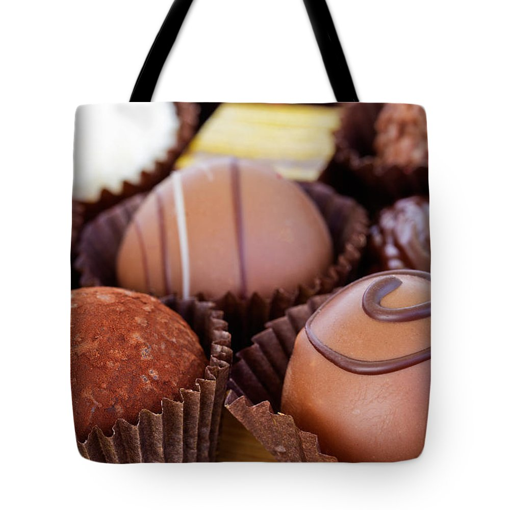 Sweet Tote Bag featuring the photograph Chocolate by Anastasy Yarmolovich