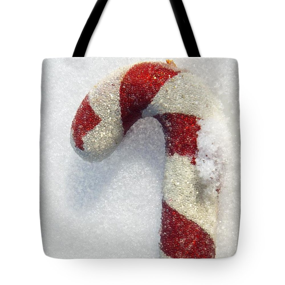 Christmas Tote Bag featuring the photograph Christmas Candy Cane On Real Snow by Isabelle Haynes