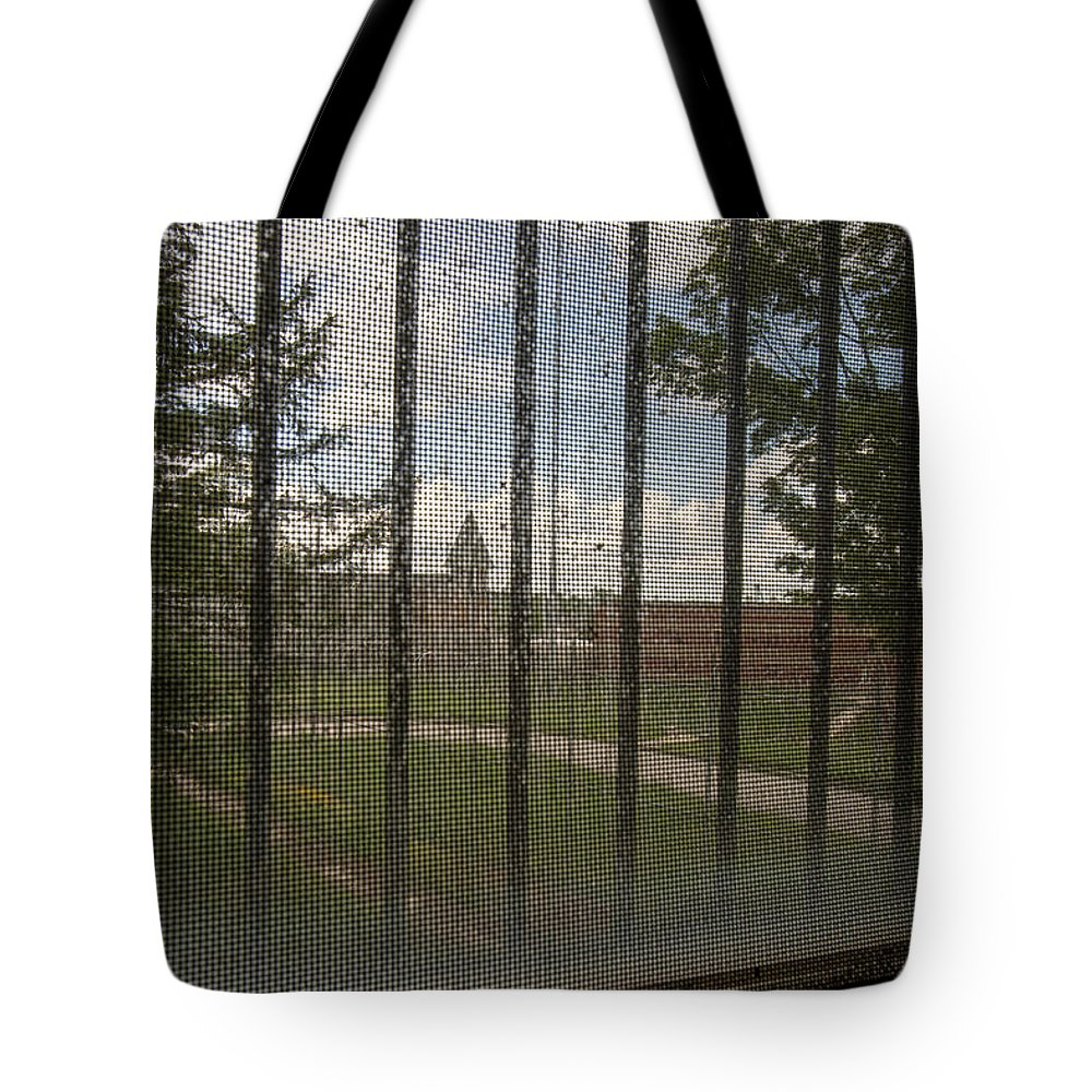 Abandoned Tote Bag featuring the photograph Church In Prison Yard Through Bars by Karen Foley