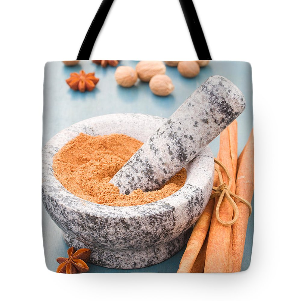 Spices Tote Bag featuring the photograph Cinnamon In Mortar by Anastasy Yarmolovich