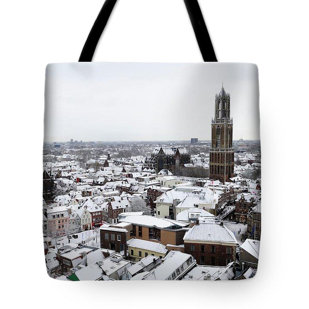 Utrecht Tote Bag featuring the photograph City Centre Of Utrecht With The Dom Tower In Winter by Merijn Van der Vliet