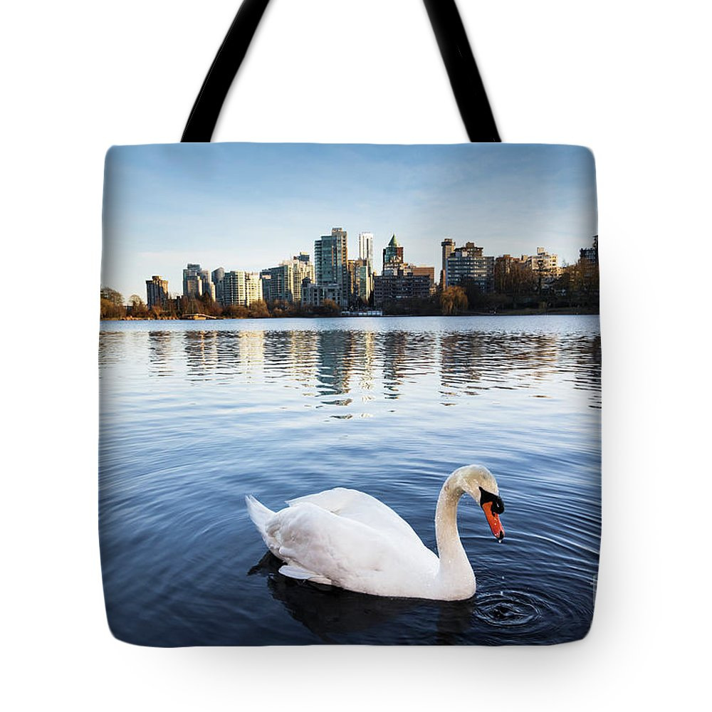 Swan Tote Bag featuring the photograph City Swan by Marc Stuelken