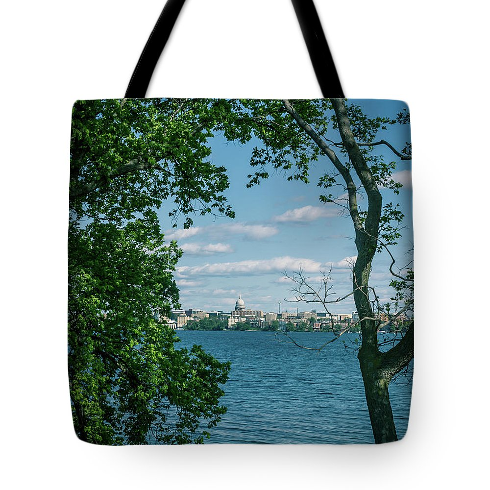 Madison Tote Bag featuring the photograph City Through The Trees by Rockland Filmworks