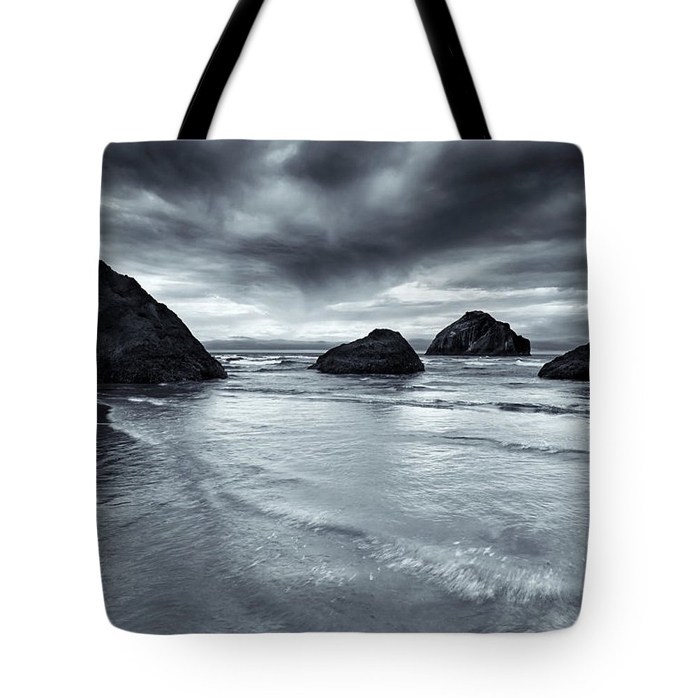 Beach Tote Bag featuring the photograph Clearing Storm by Mike Dawson