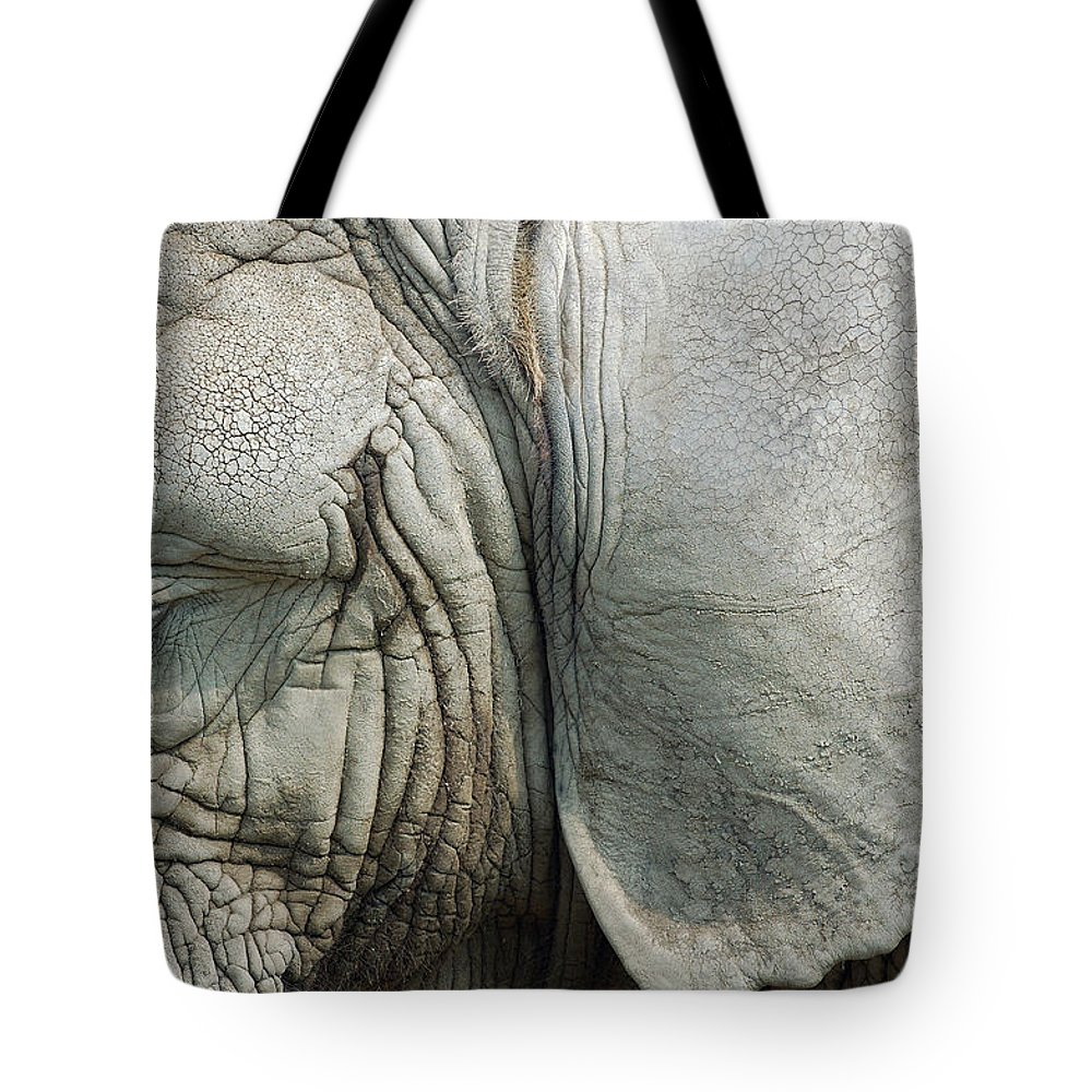 Close Up Elephant Tote Bag featuring the photograph Close Up Of Eye And Ear Of An Elephant by Reimar Gaertner