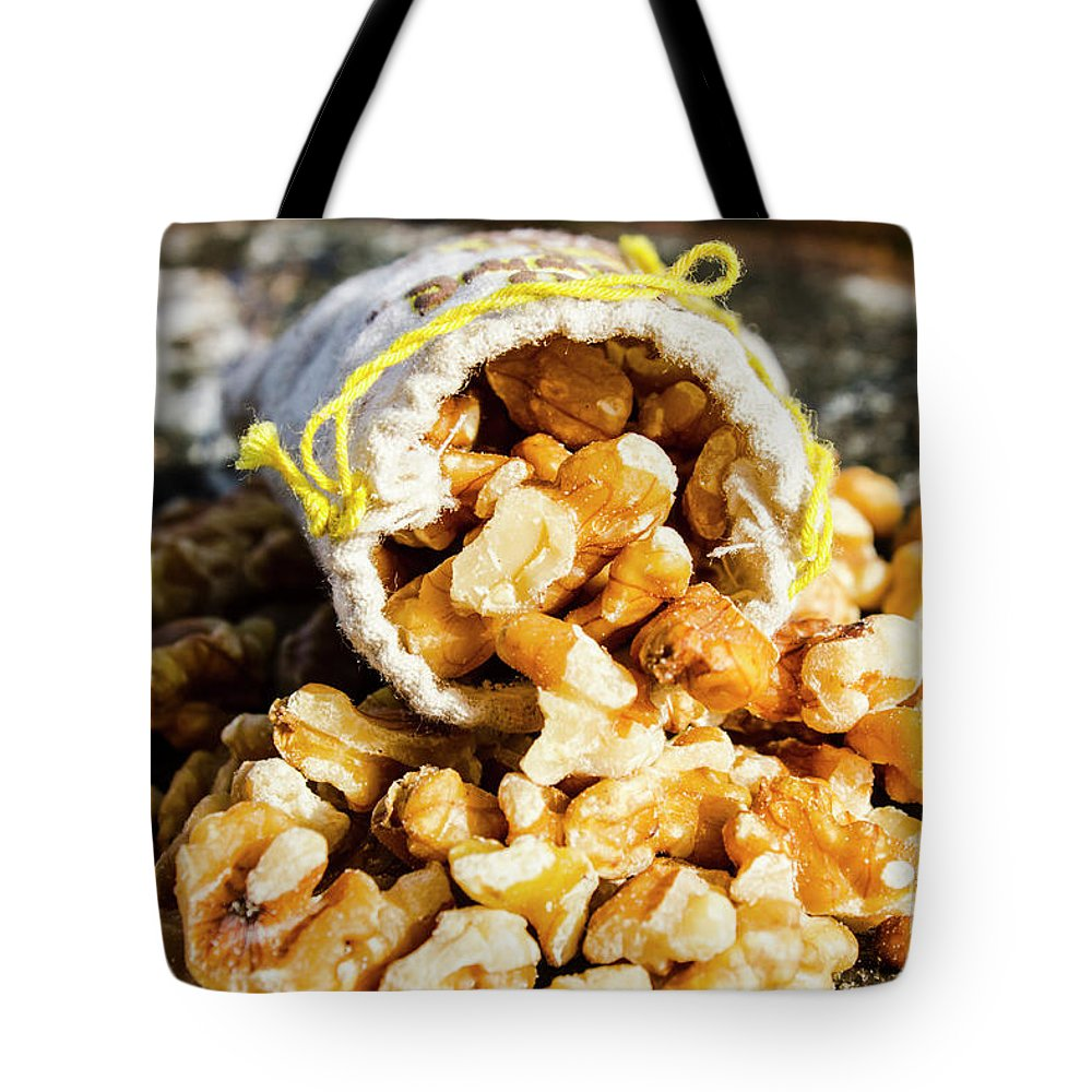 Nut Tote Bag featuring the photograph Closeup Of Walnuts Spilling From Small Bag by Jorgo Photography - Wall Art Gallery