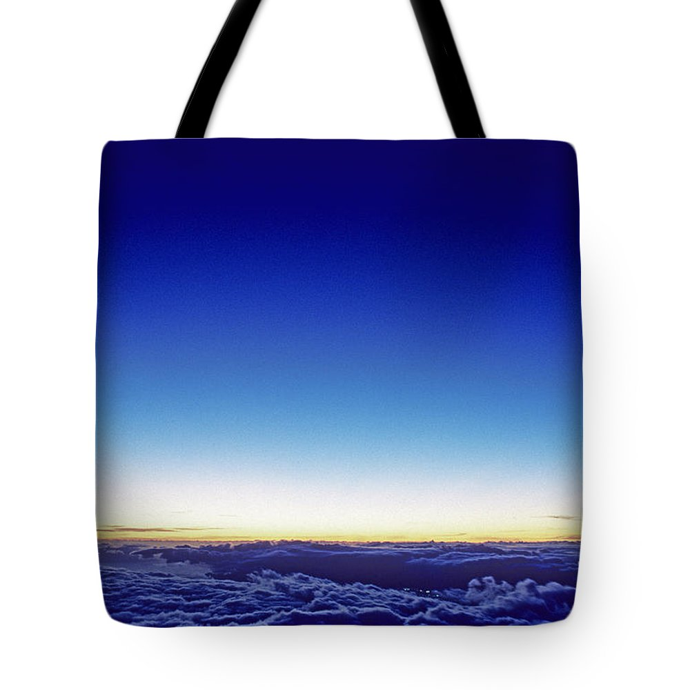 Above Tote Bag featuring the photograph Clouds At Sunset by Carl Shaneff - Printscapes