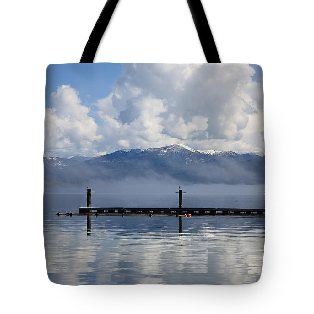 Priest Lake Tote Bag featuring the photograph Clouds Reflecting Off Priest Lake by Carol Groenen