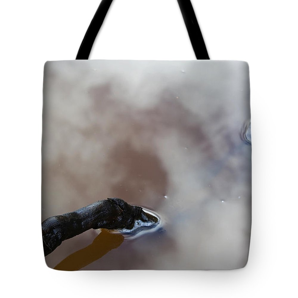 Water Tote Bag featuring the photograph Cloudy Mud Puddle by Jeff Galbraith
