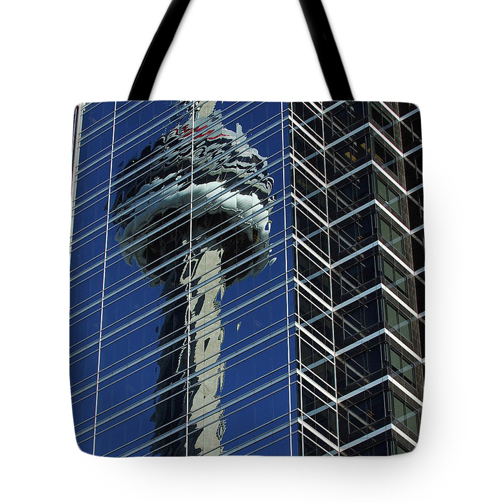 Cn Tower Reflected Reflect Glass Windows Blue Tote Bag featuring the photograph Cn Tower Reflected In A Glass Highrise by Reimar Gaertner