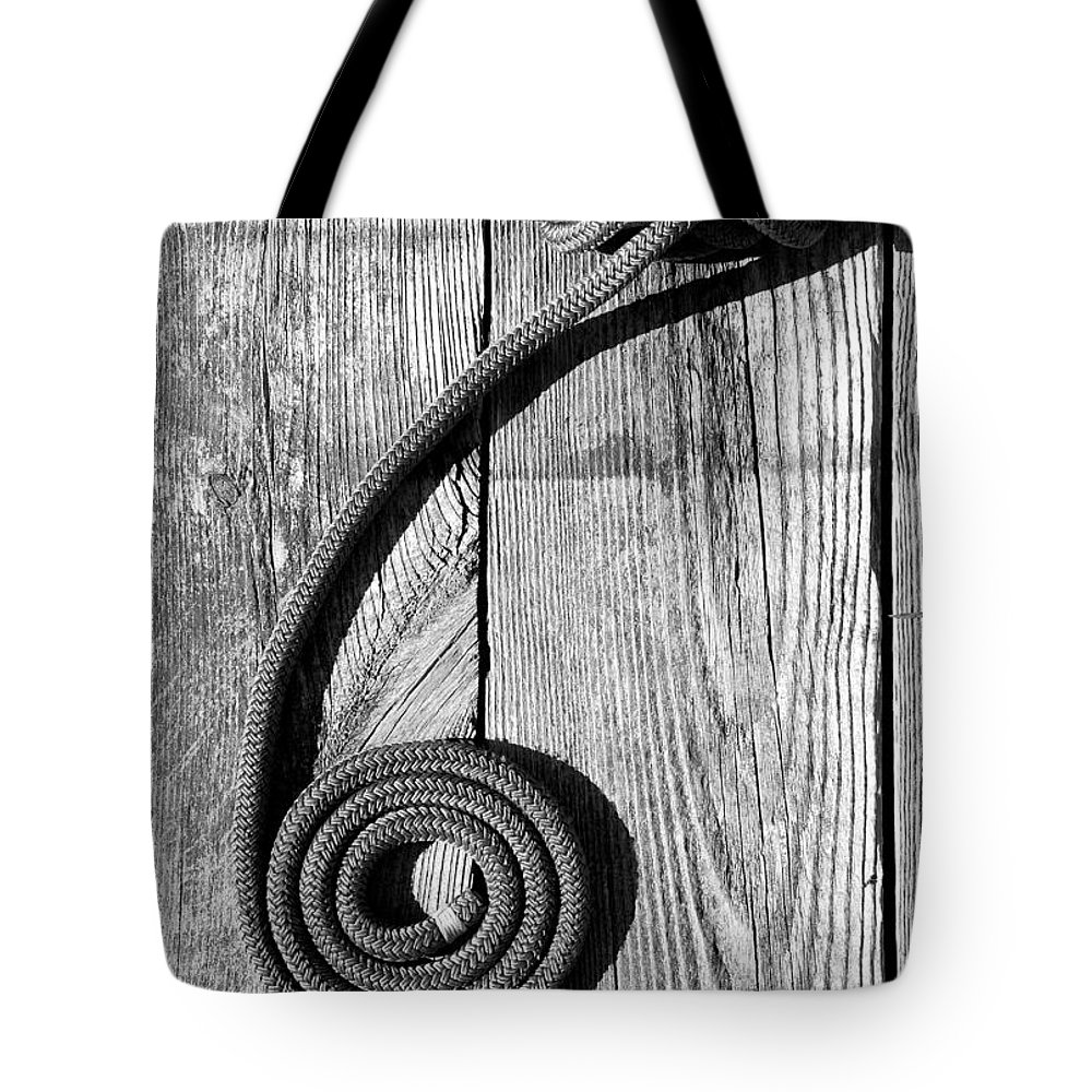 Coiled Tote Bag featuring the photograph Coiled by Charles Harden