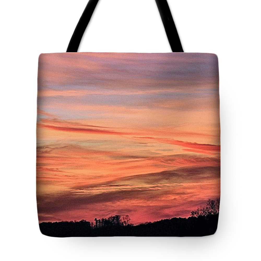 Sunsets Tote Bag featuring the photograph Colored Skies by Mike Fairchild