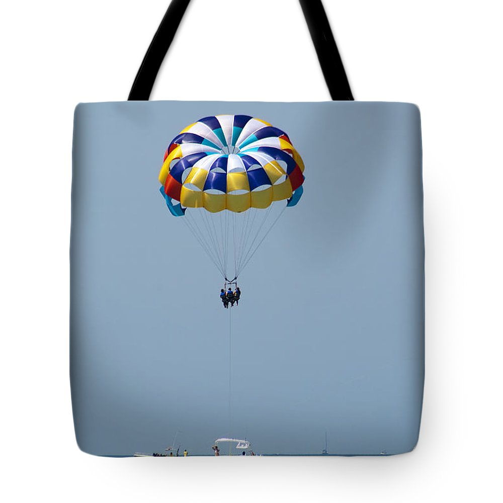 Parasailing Tote Bag featuring the photograph Colorful Parasailing by Kathy Clark