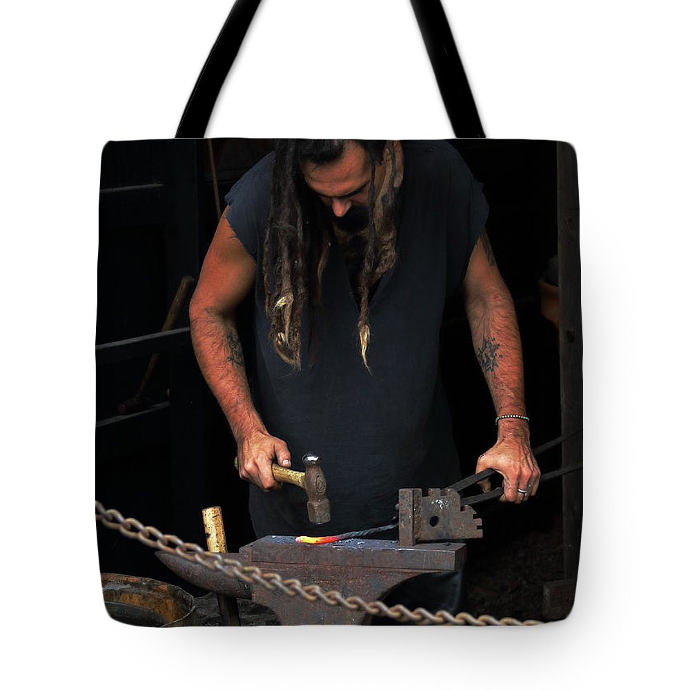 Fair Tote Bag featuring the photograph Concentration by John Wijsman