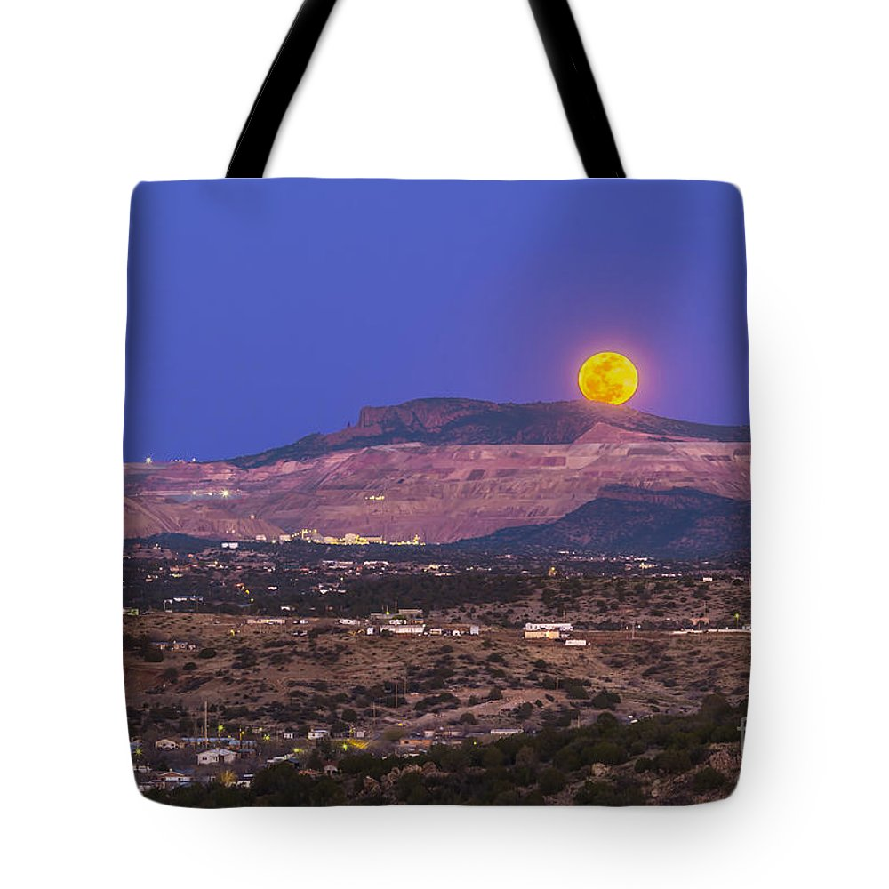 Full Moon Tote Bag featuring the photograph Copper Moon Rising Over The Santa Rita by Alan Dyer