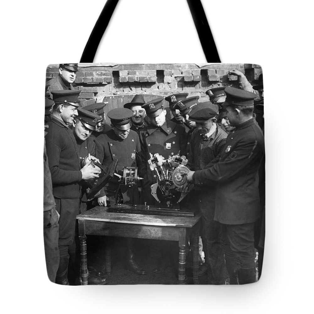 1920s Tote Bag featuring the photograph Cops Learn Motorcycle Engines by Underwood Archives