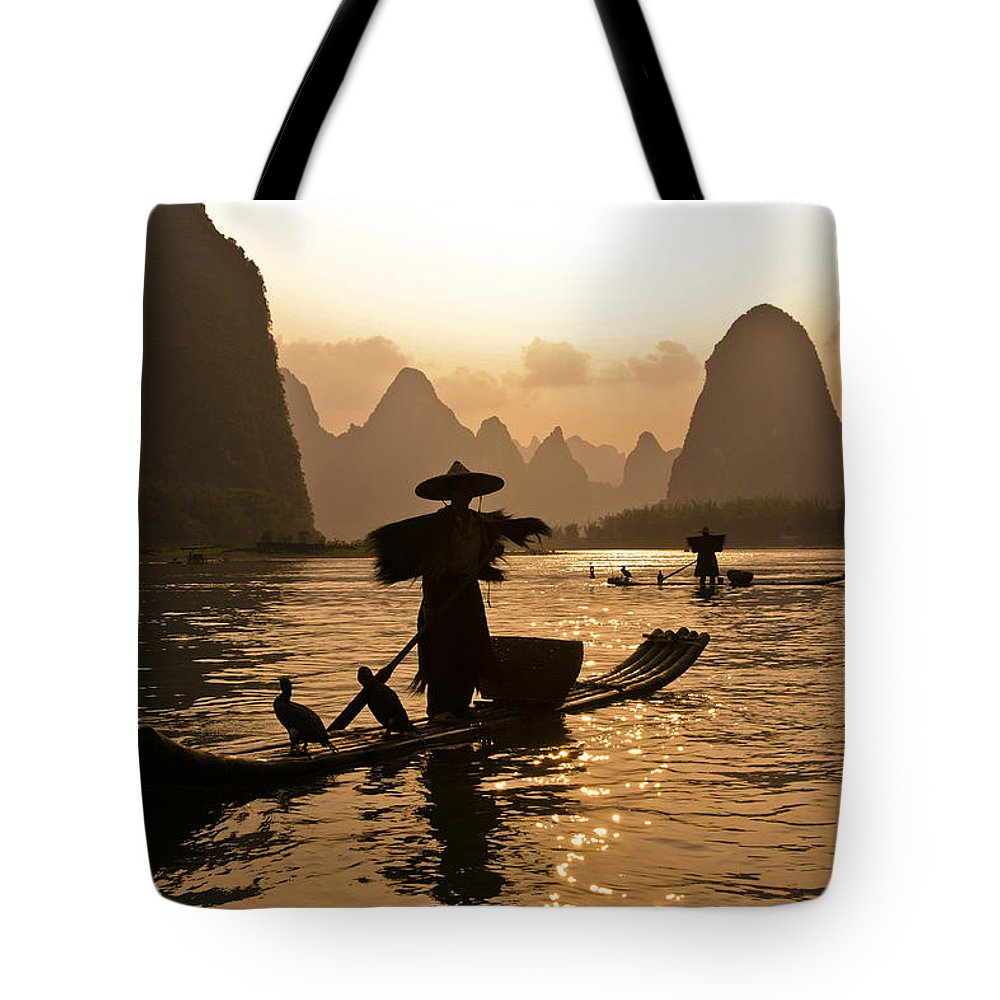 Asia Tote Bag featuring the photograph Cormorant Fisherman At Sunset by Michele Burgess