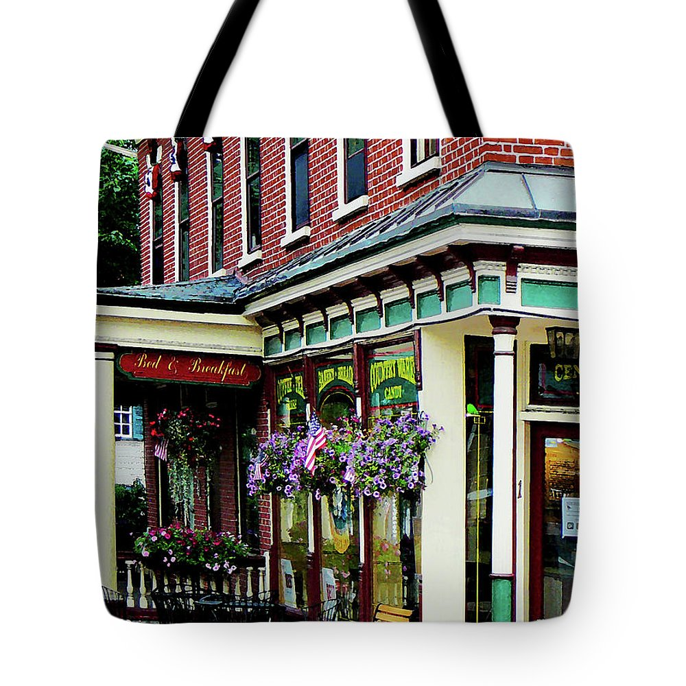 Restaurant Tote Bag featuring the photograph Corner Restaurant With Hanging Plants by Susan Savad