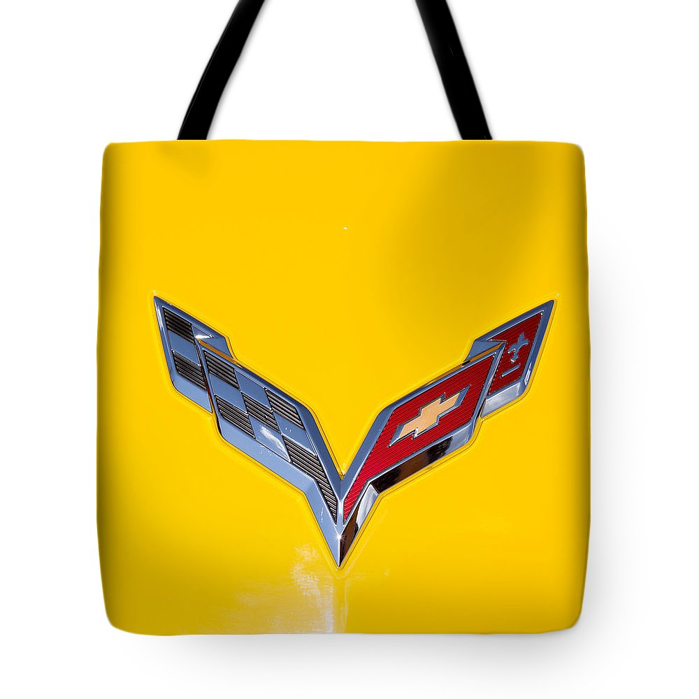 Car Emblem Tote Bag featuring the photograph Corvette Emblem On Yellow by J Darrell Hutto