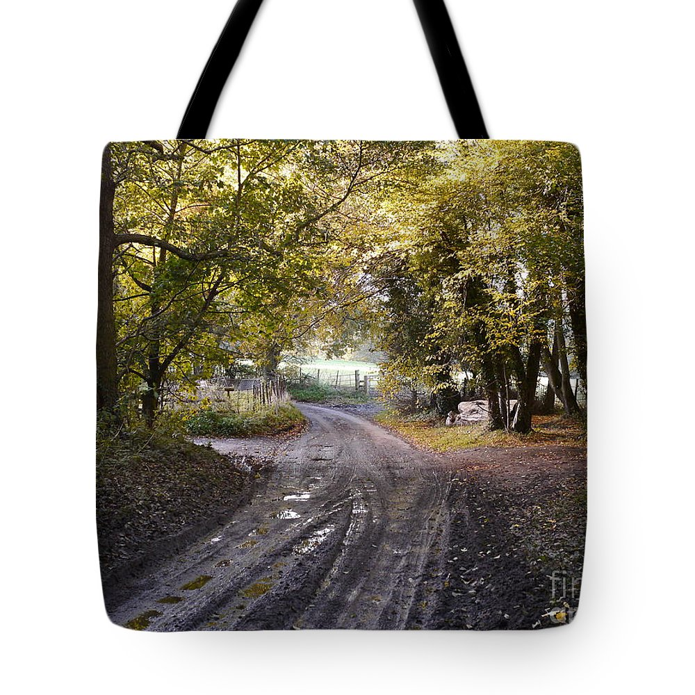 Country Lane Tote Bag featuring the photograph Country Lane In Autumn 4 by John Chatterley