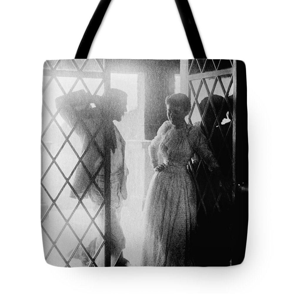19th Century Tote Bag featuring the photograph Couple In Doorway by Granger