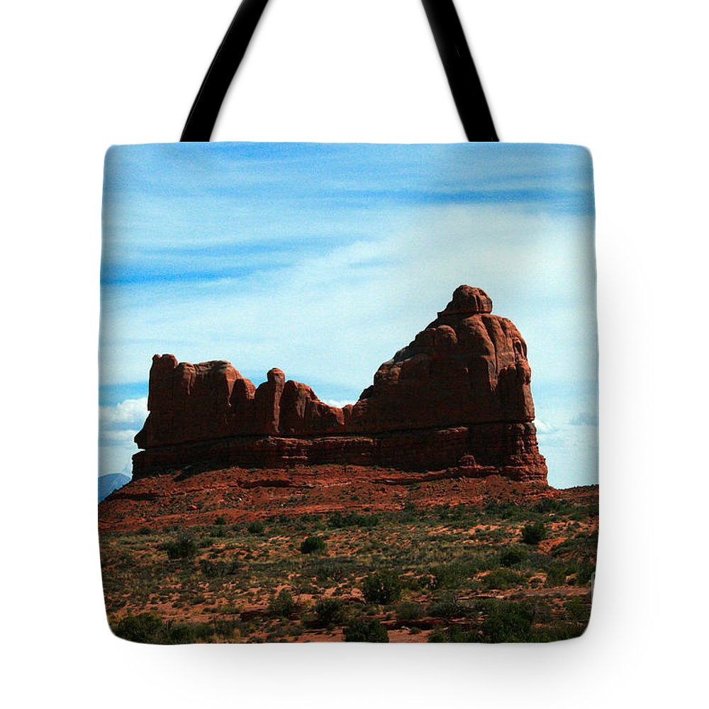 Courthouse Rock Tote Bag featuring the painting Courthouse Rock In Arches National Park by Corey Ford