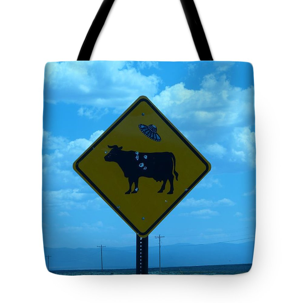 Sign Tote Bag featuring the photograph Cow With Flying Saucer by Karen Granado