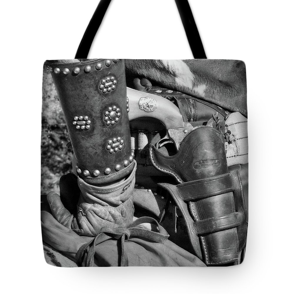 B+w Tote Bag featuring the photograph Cowboy And Six Shooter Bw by Jerry Fornarotto