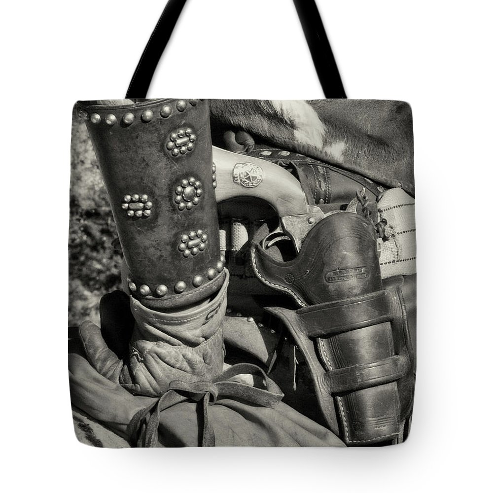 B+w Tote Bag featuring the photograph Cowboy And Six Shooter Bw Sepia by Jerry Fornarotto