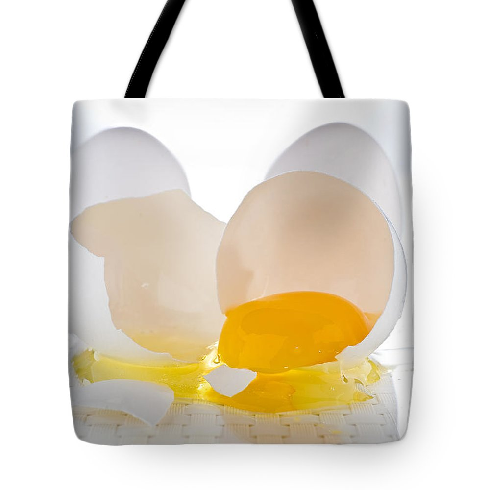 Egg Tote Bag featuring the photograph Cracked Egg by Steve Gadomski