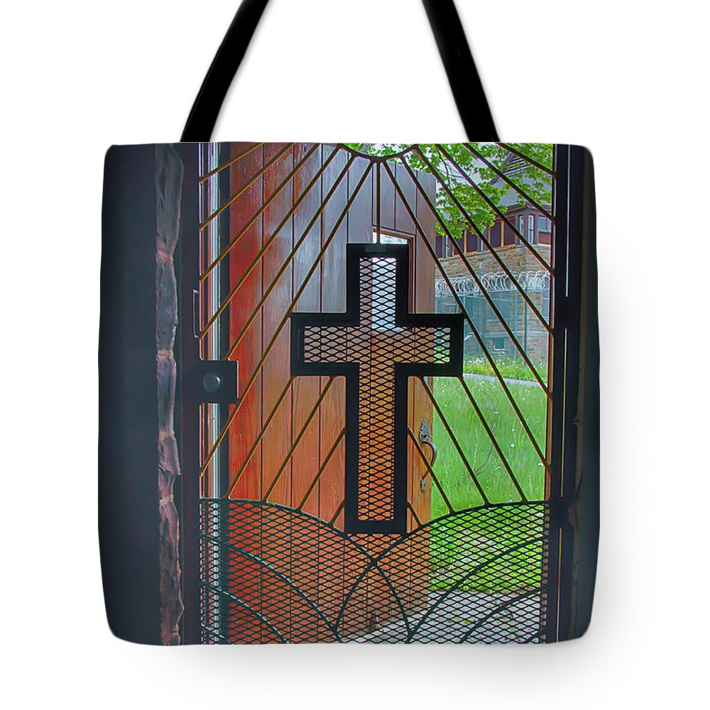 Abandoned Tote Bag featuring the photograph Cross On Church Door Open To Prison Yard With Light by Karen Foley
