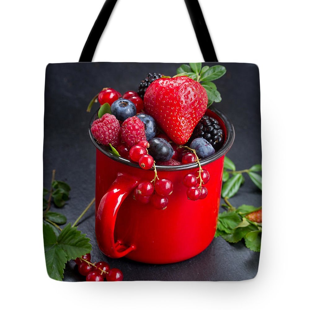 Currant Tote Bag featuring the photograph Cup Of Fresh Berries by Anastasy Yarmolovich