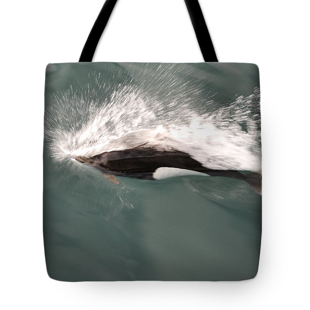 Dahl Dolphin Tote Bag featuring the photograph Dahl Dolphin by Phyllis Taylor