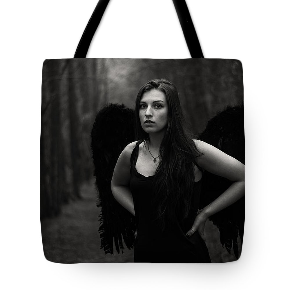 Dark Angel Tote Bag featuring the photograph Dark Angel by Brian Hughes